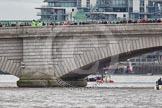 The Boat Race 2012: Minutes before the start of the 2012 Boat Race. The Oxford Blue Boat is holding back, on the right side of the image, behind a Putney Bridge that's packed with spectators..     on 07 April 2012 at 13:54, image #200
