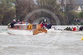 The Boat Race 2012: The 2012 Boat Race, with the boats approaching the Mile Post: On the very left the Cambridge Blue Boat, with the flotilla of boats behind, on the right of the white boat with the umpire the Oxford Blue Boat..     on 07 April 2012 at 14:17, image #277