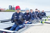 The Boat Race season 2013 - fixture OUWBC vs Molesey BC: Getting ready in the OUWBC boat: Stroke Maxie Scheske, Anastasia Chitty, Harriet Keane, Amy Varney, Joanna Lee, Mary Foord Weston, Alice Carrington-Windo, Mariann Novak.. Dorney Lake, Dorney, Windsor, Berkshire, United Kingdom, on 24 February 2013 at 11:16, image #40