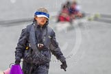 The Boat Race season 2013 - fixture OUWBC vs Olympians: OUWBC's Osiris cox Sophie Shawdon returning from a training session at Dorney Lake on a very wet day.. Dorney Lake, Dorney, Windsor, Buckinghamshire, United Kingdom, on 16 March 2013 at 10:00, image #6