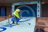 The Boat Race 2013: Cleaning the light blue carpet for the Cambridge squad, hours before the 2013 Boat Race.. Putney, London SW15,  United Kingdom, on 31 March 2013 at 11:08, image #6
