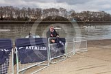 The Boat Race 2013: Getting ready for the 2013 Boat Race - covering barriers with logos of the sponsor of the event, BNY Mellon.. Putney, London SW15,  United Kingdom, on 31 March 2013 at 11:10, image #8