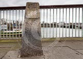 """The Boat Race 2013: """"University Boat Race"""" stone on the Putney side of the River Thames,marking the start point of the race. There is another University Boat Race Stone at the race finish line in Mortlake.. Putney, London SW15,  United Kingdom, on 31 March 2013 at 12:00, image #38"""