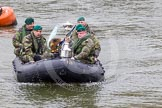 The Boat Race 2013: The 2013 Boat Race trophy is delivered by Royal Marines in a rigid inflatable boat.. Putney, London SW15,  United Kingdom, on 31 March 2013 at 14:13, image #67