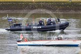 The Boat Race 2013: A Metropolitan Police high speed Rigid Inflatable Boat on the River Thames at Putney, with two Royal Marines on board, shortly before the start of the 2013 Boat Race.. Putney, London SW15,  United Kingdom, on 31 March 2013 at 14:39, image #89