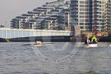 The Boat Race season 2014 - fixture OUWBC vs Molesey BC: The Molesey BC Eight on the Thames near Wandworth Bridge, with the Battersea Reach apartment blocks behind and the umpire launch on the right..     on 01 March 2014 at 12:24, image #27