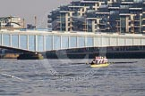 The Boat Race season 2014 - fixture OUWBC vs Molesey BC: The Molesey BC Eight on the Thames near Wandworth Bridge, with the Battersea Reach apartment blocks behind..     on 01 March 2014 at 12:24, image #28