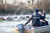 The Boat Race season 2014 - fixture OUBC vs German U23: The German U23-boat seen behind the tin boat with Oxford coach Sean Bowden.. River Thames between Putney Bridge and Chiswick Bridge,    on 08 March 2014 at 16:50, image #98