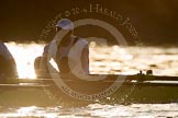 The Boat Race season 2014 - fixture OUBC vs German U23: The German U23-boat shot against the low evening sun: Bow Jonas Wiesen.. River Thames between Putney Bridge and Chiswick Bridge,    on 08 March 2014 at 16:54, image #126