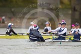The OUWBC boat - cox Jennifer Ehr, Caryn Davies, and Nadine Gradel Iberg. In the background is the Molesey BC boat.