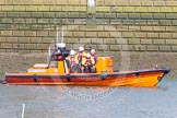 The Boat Race season 2016 -  The Cancer Research Women's Boat Race: RNLI lifeboatt E-09 in position at Putney Bridge - see http://j.mp/rnli-e-class for a highly detailed and entertaining virtual tour of the boat!. River Thames between Putney Bridge and Mortlake, London SW15,  United Kingdom, on 27 March 2016 at 13:29, image #106