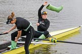 The Boat Race season 2017 - Women's Boat Race Fixture CUWBC vs Univerity of London: CUWBC's 2, Kirsten van Fosen, and bow Claire Lamb getting rid of their Wellies. River Thames between Putney Bridge and Mortlake, London SW15,  United Kingdom, on 19 February 2017 at 15:16, image #9