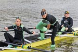 The Boat Race season 2017 - Women's Boat Race Fixture CUWBC vs Univerity of London: CUWBC's 3, Ashton Brown, 2 Kirsten van Fosen, and bow Claire Lamb getting rid of their Wellies. River Thames between Putney Bridge and Mortlake, London SW15,  United Kingdom, on 19 February 2017 at 15:16, image #10