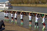 The Boat Race season 2017 -  The Cancer Research Women's Boat Race: CUWBC carrying the Cambridge boat from the boat house and turning it around to put it into the river. River Thames between Putney Bridge and Mortlake, London SW15,  United Kingdom, on 02 April 2017 at 15:47, image #60