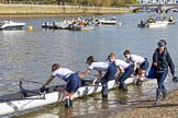 The Boat Race season 2017 -  The Cancer Research Women's Boat Race: OUWBC getting their boat into the water, here 4 Rebecca Esselstein, 3 Rebecca Te Water Naudé, 2 Flo Pickles, bow Alice Roberts, and cox Eleanor Shearer. River Thames between Putney Bridge and Mortlake, London SW15,  United Kingdom, on 02 April 2017 at 15:50, image #81