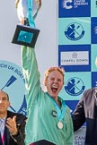 The Boat Race season 2017 -  The Cancer Research Women's Boat Race: A jubilant Ashton Brown with the Women's Boat Race trophy at the price giving. River Thames between Putney Bridge and Mortlake, London SW15,  United Kingdom, on 02 April 2017 at 17:11, image #235