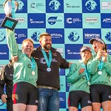 The Boat Race season 2017 -  The Cancer Research Women's Boat Race: CUWBC celebrating their win with the Women's Boat Race trophy - cox Ashton Brown, head coach Rob Barker,. River Thames between Putney Bridge and Mortlake, London SW15,  United Kingdom, on 02 April 2017 at 17:11, image #238