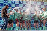 The Boat Race season 2017 -  The Cancer Research Women's Boat Race: CUWBC covered in spray (Cahmpagne, not Thames water) at the price giving. River Thames between Putney Bridge and Mortlake, London SW15,  United Kingdom, on 02 April 2017 at 17:13, image #260