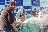 The Boat Race season 2017 -  The Cancer Research Women's Boat Race: CUWBC head coach Rob Barker spraying Champagne at the crew, on his right cox Matthew Holland. River Thames between Putney Bridge and Mortlake, London SW15,  United Kingdom, on 02 April 2017 at 17:13, image #261
