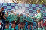 The Boat Race season 2017 -  The Cancer Research Women's Boat Race: CUWBC covered in spray (Cahmpagne, not Thames water) at the price giving. River Thames between Putney Bridge and Mortlake, London SW15,  United Kingdom, on 02 April 2017 at 17:13, image #266