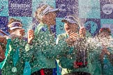 The Boat Race season 2017 -  The Cancer Research Women's Boat Race: CUWBC covered in spray (Cahmpagne, not Thames water) at the price giving. River Thames between Putney Bridge and Mortlake, London SW15,  United Kingdom, on 02 April 2017 at 17:13, image #267