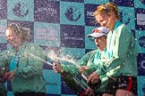 The Boat Race season 2017 -  The Cancer Research Women's Boat Race: CUWBC spraying the Champagne at the price giving - stroke Melissa Wilson, and cox Matthew Holland, and 4 seat Anna Dawson. River Thames between Putney Bridge and Mortlake, London SW15,  United Kingdom, on 02 April 2017 at 17:13, image #268