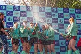 The Boat Race season 2017 -  The Cancer Research Women's Boat Race: CUWBC covered in spray (Cahmpagne, not Thames water) at the price giving. River Thames between Putney Bridge and Mortlake, London SW15,  United Kingdom, on 02 April 2017 at 17:13, image #270