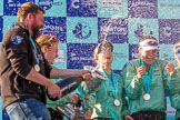 The Boat Race season 2017 -  The Cancer Research Women's Boat Race: CUWBC head coach Rob Barker spraying Champagne at the crew - here bow Ashton Brown, 2 Imogen Grant, and 3 Claire Lambe. River Thames between Putney Bridge and Mortlake, London SW15,  United Kingdom, on 02 April 2017 at 17:13, image #271