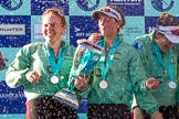 The Boat Race season 2017 -  The Cancer Research Women's Boat Race: CUWBC and lots of Champagne, here, with the Women's Boat Race trophy, bow Ashton Brown, 2 Imogen Grant, and 3 Claire Lambe. River Thames between Putney Bridge and Mortlake, London SW15,  United Kingdom, on 02 April 2017 at 17:13, image #274
