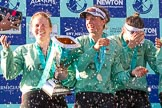 The Boat Race season 2017 -  The Cancer Research Women's Boat Race: CUWBC and lots of Champagne, here, with the Women's Boat Race trophy, bow Ashton Brown, 2 Imogen Grant, and 3 Claire Lambe. River Thames between Putney Bridge and Mortlake, London SW15,  United Kingdom, on 02 April 2017 at 17:13, image #275