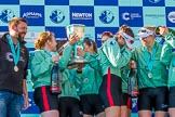 The Boat Race season 2017 -  The Cancer Research Women's Boat Race: CUWBC after the Chanpange spraying at the price giving, with the Women's Boat Race trophy. On the left head coach Rob Barker. River Thames between Putney Bridge and Mortlake, London SW15,  United Kingdom, on 02 April 2017 at 17:13, image #288