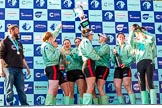 The Boat Race season 2017 -  The Cancer Research Women's Boat Race: CUWBC after the Chanpange spraying at the price giving, with the Women's Boat Race trophy. On the left head coach Rob Barker. River Thames between Putney Bridge and Mortlake, London SW15,  United Kingdom, on 02 April 2017 at 17:13, image #290