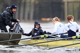 "The Boat Race season 2018 - Women's Boat Race Trial Eights (OUWBC, Oxford): The ""Coursing River"" crew handing over clothes before the race - cox Ellie Shearer, stroke Beth Bridgman, 7 Juliette Perry. Who is the gentleman in the tin boat?. River Thames between Putney Bridge and Mortlake, London SW15,  United Kingdom, on 21 January 2018 at 14:21, image #33"