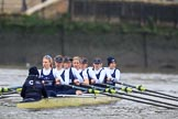 "The Boat Race season 2018 - Women's Boat Race Trial Eights (OUWBC, Oxford): Rowing towards the start line in the rain - ""Coursing River"" with cox Ellie Shearer, stroke Beth Bridgman, 7 Juliette Perry, 6 Katherine Erickson, 5 Morgan McGovern, 4 Anna Murgatroyd, 3 Stefanie Zekoll, 2 Rachel Anderson, bow Sarah Payne-Riches. River Thames between Putney Bridge and Mortlake, London SW15,  United Kingdom, on 21 January 2018 at 14:24, image #42"