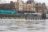"The Boat Race season 2018 - Women's Boat Race Trial Eights (OUWBC, Oxford): ""Great Typhoon"" and ""Coursing River"" at the start line, with both coxes indicating that they are not ready yet. River Thames between Putney Bridge and Mortlake, London SW15,  United Kingdom, on 21 January 2018 at 14:27, image #45"