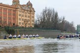 "The Boat Race season 2018 - Women's Boat Race Trial Eights (OUWBC, Oxford): ""Coursing River"" and ""Great Typhoon"" passing the Harrods Depository. River Thames between Putney Bridge and Mortlake, London SW15,  United Kingdom, on 21 January 2018 at 14:33, image #86"