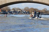 The Women's Boat Race season 2018 - fixture CUWBC vs. ULBC: ULBC, on the left, and CUWBC, in front of the umpire's boat, below Putney Bridge, rowuing towards their start positions. River Thames between Putney Bridge and Mortlake, London SW15,  United Kingdom, on 17 February 2018 at 13:08, image #35