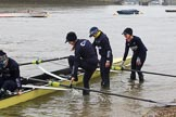 The Women's Boat Race season 2018 - fixture OUWBC vs. Molesey BC: OUWBC getting the boat ready on a cold and rainy day, here 4 seat Alice Roberts, 3 Juliette Perry, 2 Katherine Erickson, bow Renée Koolschijn. River Thames between Putney Bridge and Mortlake, London SW15,  United Kingdom, on 04 March 2018 at 13:04, image #1