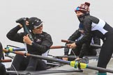 The Women's Boat Race season 2018 - fixture OUWBC vs. Molesey BC: Molesey's 3 seat Gabby Rodriguez about to throw her wellies, 2 seat Lucy Primmer, and bow Emma Boyns. River Thames between Putney Bridge and Mortlake, London SW15,  United Kingdom, on 04 March 2018 at 13:09, image #17