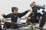 The Women's Boat Race season 2018 - fixture OUWBC vs. Molesey BC: Molesey's 3 seat Gabby Rodriguez throwing one of  her wellies, 2 seat Lucy Primmer, and bow Emma Boyns. River Thames between Putney Bridge and Mortlake, London SW15,  United Kingdom, on 04 March 2018 at 13:09, image #18