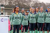 The Cancer Research UK Women's Boat Race 2018: The Cambridge women at the toss - president Daphne Martschenko, cox Sophie Shapter, 6 seat Alice White, 7  Myriam Goudet-Boukhatmi, stroke Olivia Coffey, and behind 2  Imogen Grant, 3 Kelsey Barolak, 4 Thea Zabell, and 5 Paula Wesselmann. River Thames between Putney Bridge and Mortlake, London SW15,  United Kingdom, on 24 March 2018 at 14:40, image #33