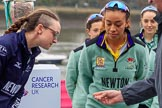 The Cancer Research UK Women's Boat Race 2018: OUWBC president Katherine Erickson and CUWBC president Daphne Martschenko at the toss, looking at the coin in Sir Matthew Pinsent's hand. River Thames between Putney Bridge and Mortlake, London SW15,  United Kingdom, on 24 March 2018 at 14:40, image #41