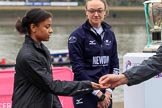 The Cancer Research UK Women's Boat Race 2018: Zahara Alacia, a 15 years old member of the Boat Race Future Blues Programme, receiving the coin for the toss. Behind her OUWBC president Katherine Erickson. River Thames between Putney Bridge and Mortlake, London SW15,  United Kingdom, on 24 March 2018 at 14:40, image #42