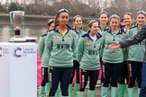 The Cancer Research UK Women's Boat Race 2018: The Cambridge crew with the Women's Boat Race trophy at the toss - president Daphne Martschenko (rowing in the reserve boat), cox Sophie Shapter, 6 Alice White, 7 Myriam Goudet-Boukhatmi, and in the second row 2 seat Imogen Grant, 3 Kelsey Barolak, 4 Thea Zabell, and 5 Paula Wesselmann. River Thames between Putney Bridge and Mortlake, London SW15,  United Kingdom, on 24 March 2018 at 14:41, image #44