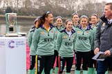 The Cancer Research UK Women's Boat Race 2018: The Cambridge crew with the Women's Boat Race trophy at the toss - president Daphne Martschenko (rowing in the reserve boat), cox Sophie Shapter, 6 Alice White, 7 Myriam Goudet-Boukhatmi, and in the second row 2 seat Imogen Grant, 3 Kelsey Barolak, 4 Thea Zabell, and 5 Paula Wesselmann. On the right race umpire Sir Matthew Pinsent.. River Thames between Putney Bridge and Mortlake, London SW15,  United Kingdom, on 24 March 2018 at 14:41, image #47