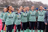The Cancer Research UK Women's Boat Race 2018: The Cambridge crew  at the toss - president Daphne Martschenko (rowing in the reserve boat), cox Sophie Shapter, 6 Alice White, 7 Myriam Goudet-Boukhatmi, and in the second row 3 Kelsey Barolak, 4 Thea Zabell, and 5 Paula Wesselmann. On the right race umpire Sir Matthew Pinsent.. River Thames between Putney Bridge and Mortlake, London SW15,  United Kingdom, on 24 March 2018 at 14:41, image #49