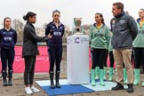 The Cancer Research UK Women's Boat Race 2018: Zahara Alacia, the young lady throwing the coin at the reserve boat toss, with Oxford stroke Anna Murgatroyd on the left, and Cambridge president Daphne Martschenko on the right of the Women's Boat Race trophy. River Thames between Putney Bridge and Mortlake, London SW15,  United Kingdom, on 24 March 2018 at 14:55, image #71