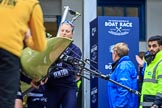 The Cancer Research UK Women's Boat Race 2018: THe Oxford boat, with the BBC camera assembly mounted on the rear, is carried out of the boathouse, In front stroke Beth Bridgman. River Thames between Putney Bridge and Mortlake, London SW15,  United Kingdom, on 24 March 2018 at 15:42, image #88