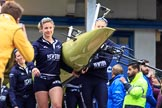 The Cancer Research UK Women's Boat Race 2018: THe Oxford boat, with the BBC camera assembly mounted on the rear, is carried out of the boathouse. In front 5 seat Morgan McGovern. River Thames between Putney Bridge and Mortlake, London SW15,  United Kingdom, on 24 March 2018 at 15:42, image #89