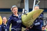 The Cancer Research UK Women's Boat Race 2018: THe Oxford boat, with the BBC camera assembly mounted on the rear, is carried out of the boathouse. In front 5 seat Morgan McGovern. River Thames between Putney Bridge and Mortlake, London SW15,  United Kingdom, on 24 March 2018 at 15:42, image #90